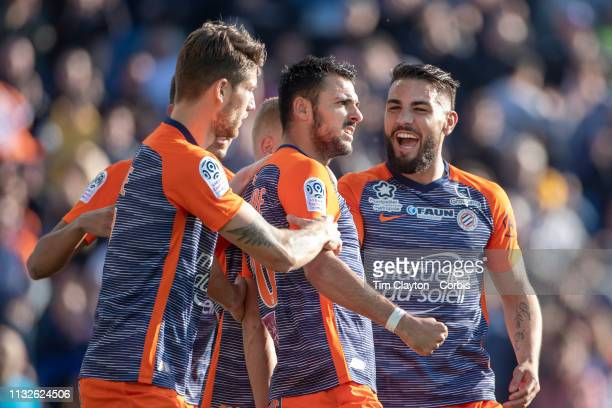 February 24: Gaetan Laborde of Montpellier celebrates after scoring his side second goal with team mate Andy Delort of Montpellier during the...