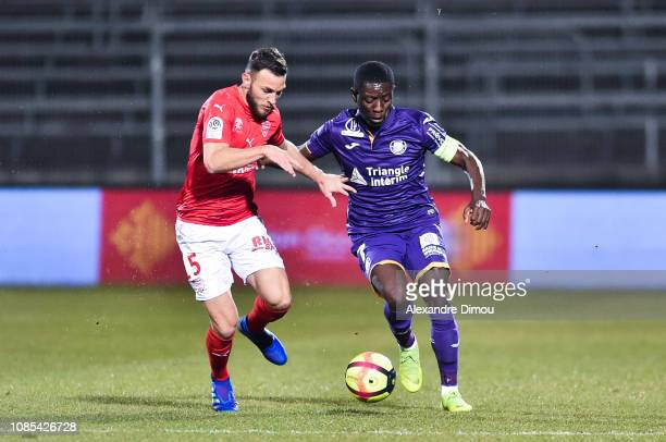 Gaetan Paquiez of Nimes and Max Alain Gradel of Toulouse during the Ligue 1 match between Nimes and Toulouse at Stade des Costieres on January 19...