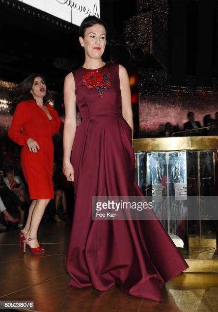 Gaetane Meslin by Paule Ka and Sandrine Sarroche by Philippe Perisse walk the runway during the 'Red Defile' Auction Fashion Show Hosted by Ajila...