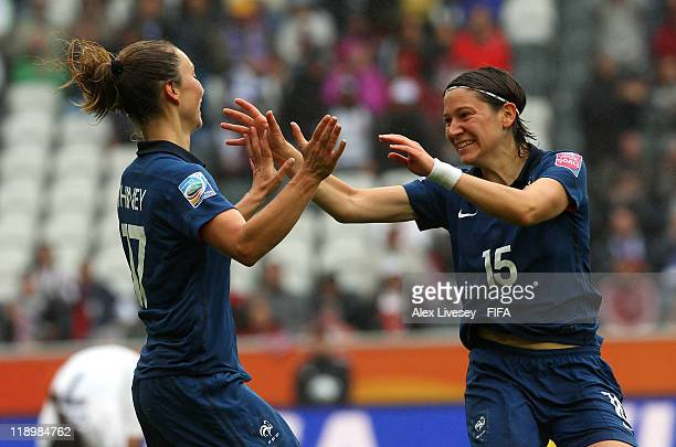 Gaetane Thiney and Elise Bussaglia of France celebrate their goal during the FIFA Women's World Cup Semi Final match between France and USA at...