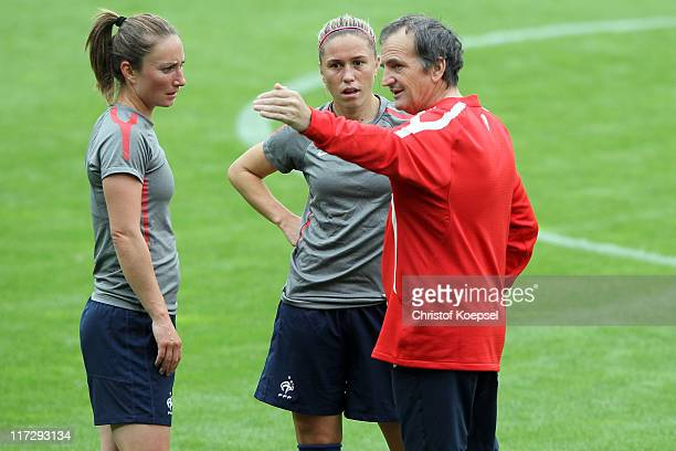 Gaetane Thiney Camille Abily and national coach Bruno Bini of France during the France Women national team traaining session at RheinNeckar Arena on...
