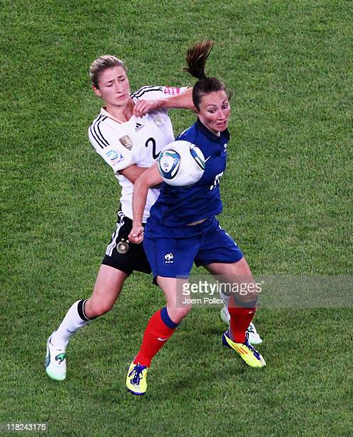 Gaetane Thiney of France and Bianca Schmidt of Germany battle for the ball during the FIFA Women's World Cup 2011 Group A match between France and...