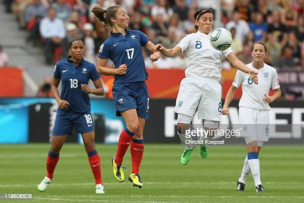 Gaetane Thiney of France and Fara Williams of England go up for a header during the FIFA Women's World Cup 2011 Quarter Final match between England...