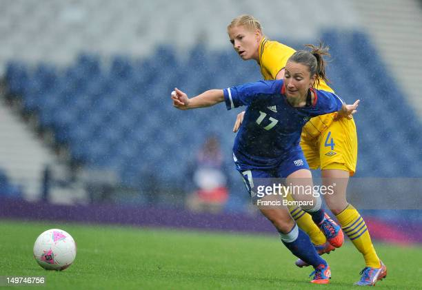 Gaetane Thiney of France battles for the ball Annica Svensson of Sweden during the Women's Football Quarter Final match between Sweden and France on...