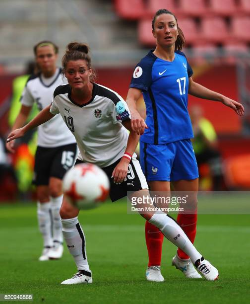 Gaetane Thiney of France battles for the ball with Verena Aschauer of Austria during the Group C match between France and Austria during the UEFA...