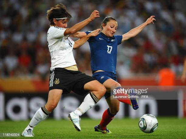 Gaetane Thiney of France battles with Ariane Hingst of Germany during the FIFA Women's World Cup 2011 Group A match between France and Germany at...