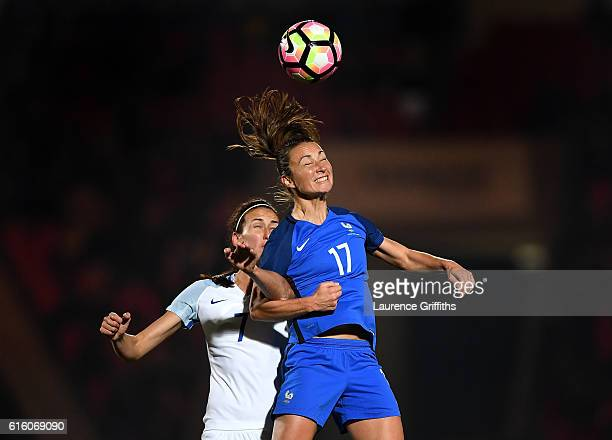 Gaetane Thiney of France battles with Jill Scott of England during the International Friendly between England and France at Keepmoat Stadium on...