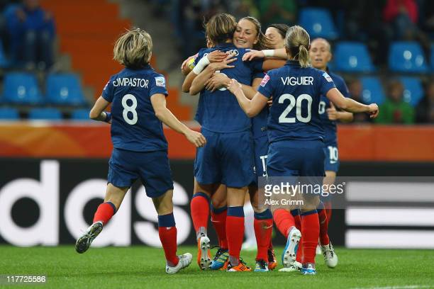 Gaetane Thiney of France celebrates her team's second goal with team mates during the FIFA Women's World Cup 2011 Group A match between Canada and...