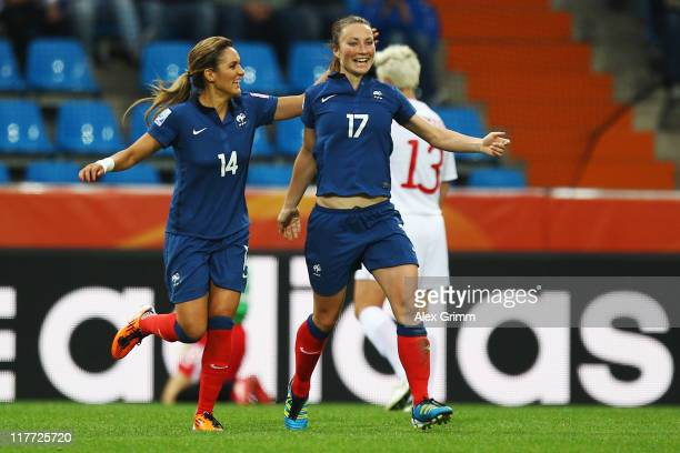 Gaetane Thiney of France celebrates her team's second goal with team mate Louisa Necib during the FIFA Women's World Cup 2011 Group A match between...