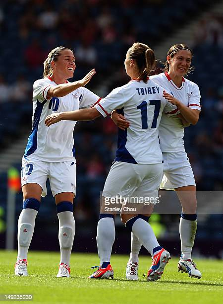 Gaetane Thiney of France celebrates with teammates after scoring a goal during the Women's Football first round Group G Match of the London 2012...