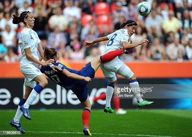 Gaetane Thiney of France challenges Jill Scott and Fara Williams of England during the FIFA Women's World Cup 2011 Quarter Final match between...
