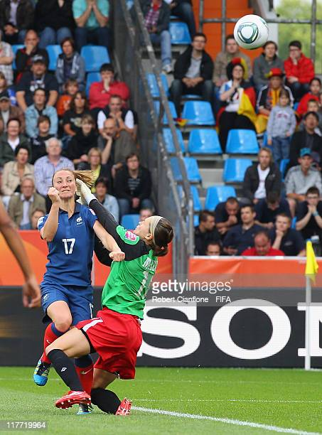 Gaetane Thiney of France gets the ball over Canadian goalkeeper Erin McLeod to score during the FIFA Women's World Cup 2011 Group A match between...
