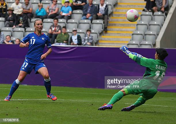 Gaetane Thiney of France has her shot on goal saved by Colombian goalkeeper Sandra Sepulveda during the Women's Football first round Group G match...