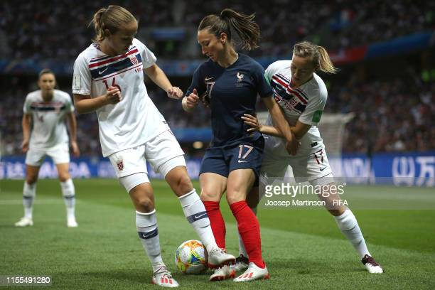 Gaetane Thiney of France is challenged by Guro Reiten and Kristine Minde of Norway during the 2019 FIFA Women's World Cup France group A match...