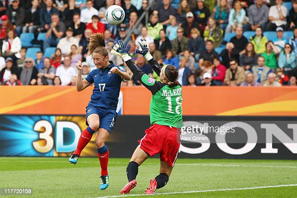Gaetane Thiney of France scores her team's first goal against goalkeeper Erin McLeod of Canada during the FIFA Women's World Cup 2011 Group A match...