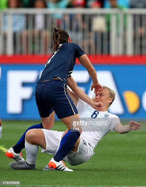 Gaetane Thiney of France shoves Laura Bassett of England in the first half during the FIFA Women's World Cup 2015 Group F match at Moncton Stadium on...