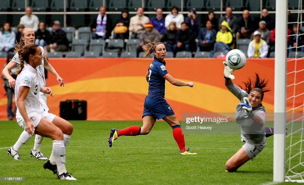 Gaetane Thiney of France (C) watches as a cross from Sonia Bompastor (not pictured) floats past Hope Solo of USA to make it 1-1 during the FIFA Women's World Cup 2011 Semi Final match between France and USA at Borussia Park on July 13, 2011 in Moenchengladbach, Germany.