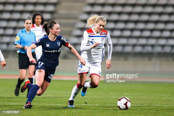 Gaetane Thiney of Paris FC and Ada Hegerberg of Lyon during the women's division 1 match between Paris FC and Lyon at Stade Charlety on February 20...