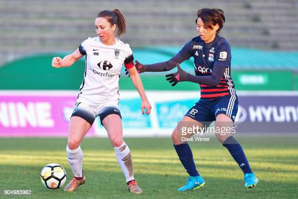 Gaetane Thiney of Paris FC and Saki Kumagai of Lyon during the Division 1 match between Paris FC and Lyon on January 14 2018 in Evry Bondoufle France