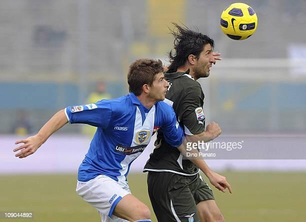 Gaetano Berardi of Brecia competes for the ball with Giuseppe Sculli of Lazio during the Serie A match between Brescia Calcio and SS Lazio at Mario...