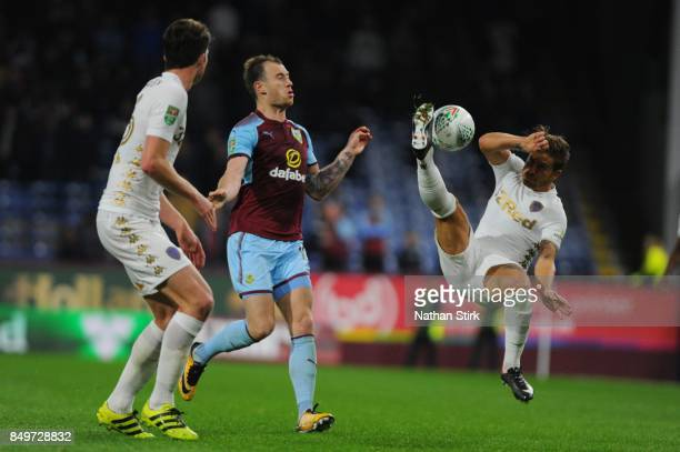 Gaetano Berardi of Leeds and Ashley Barnes of Burnley in action during the Carabao Cup Third Round match between Burnley and Leeds United at Turf...