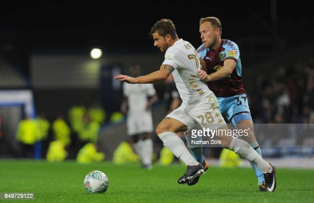 Gaetano Berardi of Leeds and Scott Arfield of Burnley in action during the Carabao Cup Third Round match between Burnley and Leeds United at Turf...