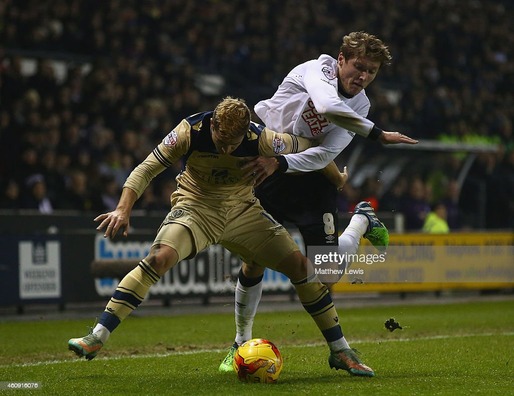 Gaetano Berardi of Leeds United and Jeff Hendrick of Derby County challenge for the ball during the Sky Bet Championship match between Derby County and Leeds United at Pride Park Stadium on December 30, 2014 in Derby, England.