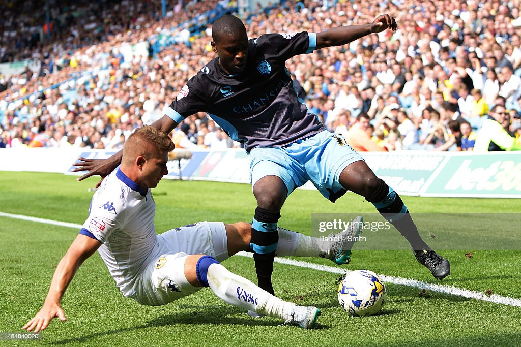 Gaetano Berardi of Leeds United FC tackles Jeremy Helan of Sheffield Wednesday FC during the Sky Bet Championship match between Leeds United and Sheffield Wednesday at Elland Road on August 22, 2015 in Leeds, England.