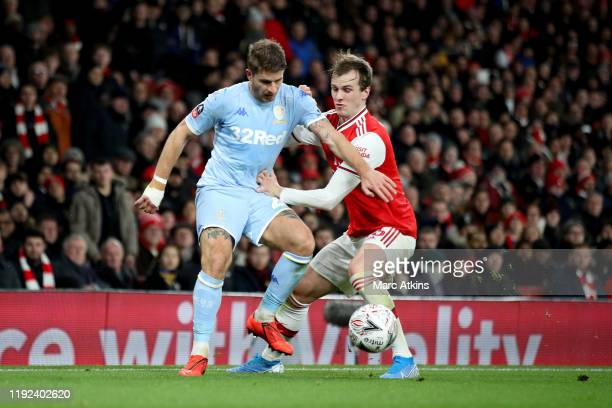 Gaetano Berardi of Leeds United in action with Rob Holding of Arsenal during the FA Cup Third Round match between Arsenal and Leeds United at...