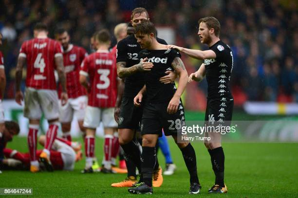 Gaetano Berardi of Leeds United is restrained by team mates after a clash with Matt Taylor of Bristol City resulting in a red card for both during...