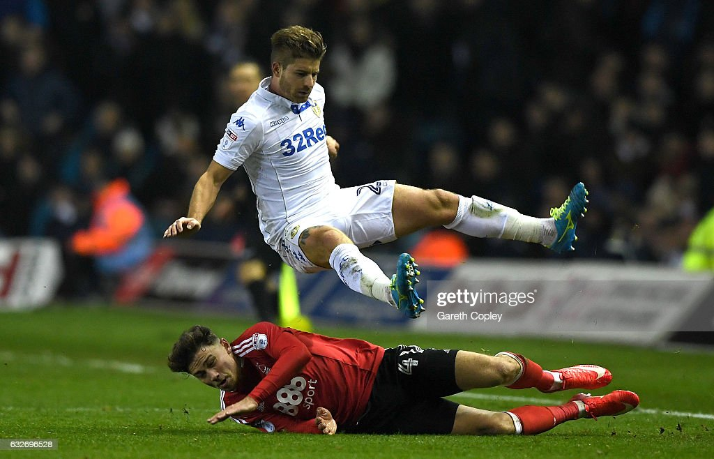 Gaetano Berardi of Leeds United rides a tackle from Matty Cash of Nottingham Forest during the Sky Bet Championship match between Leeds United and Nottingham Forest at Elland Road on January 25, 2017 in Leeds, England.
