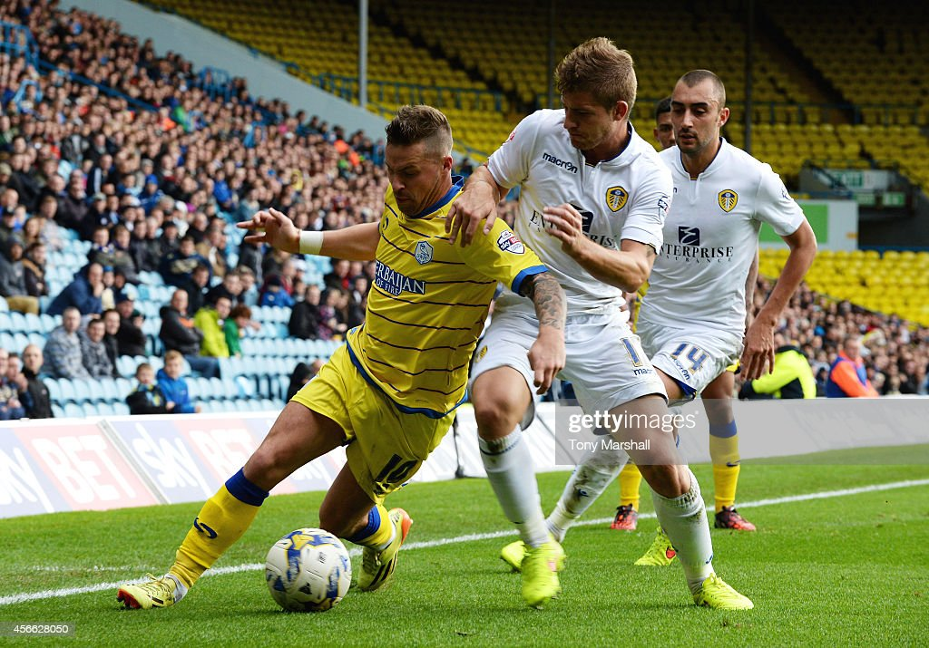 Gaetano Berardi of Leeds United tackles Chris Maguire of Sheffield Wednesday during the Sky Bet Championship match between Leeds United and Sheffield Wednesday at Elland Road on October 4, 2014 in Leeds, England.