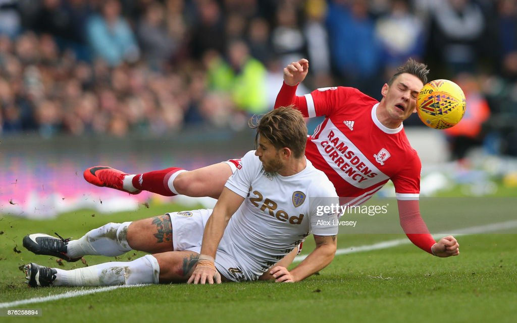 Gaetano Berardi of Leeds United tackles Connor Roberts of Middlesbrough during the Sky Bet Championship match between Leeds United and Middlesbrough at Elland Road on November 19, 2017 in Leeds, England.
