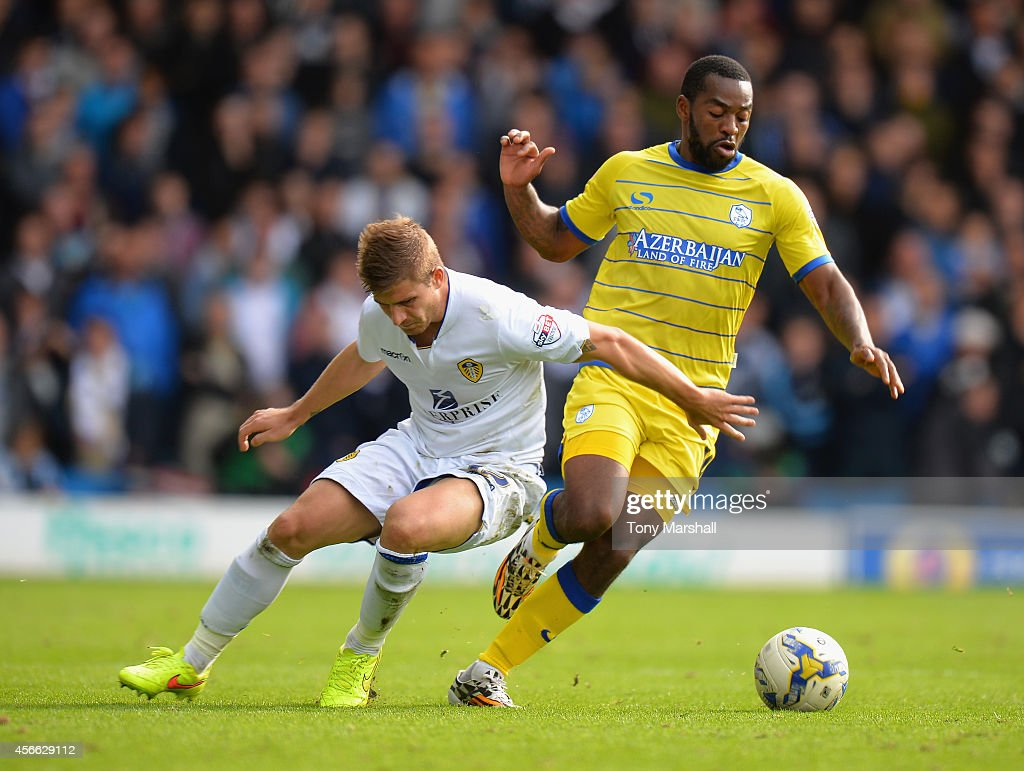Gaetano Berardi of Leeds United tackles Jacques Maghoma of Sheffield Wednesday during the Sky Bet Championship match between Leeds United and Sheffield Wednesday at Elland Road on October 4, 2014 in Leeds, England.