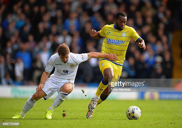 Gaetano Berardi of Leeds United tackles Jacques Maghoma of Sheffield Wednesday during the Sky Bet Championship match between Leeds United and...