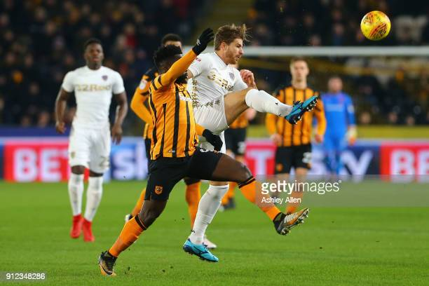 Gaetano Berardi of Leeds United wins the ball from Hull City's Nouha Dicko during the Sky Bet Championship match between Hull City and Leeds United...