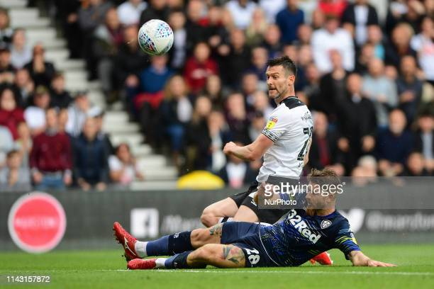 Gaetano Berardi of Leeds Utd tackles David Nugent of Derby County during the Sky Bet Championship Play off Semi Final 1st leg match between Derby...