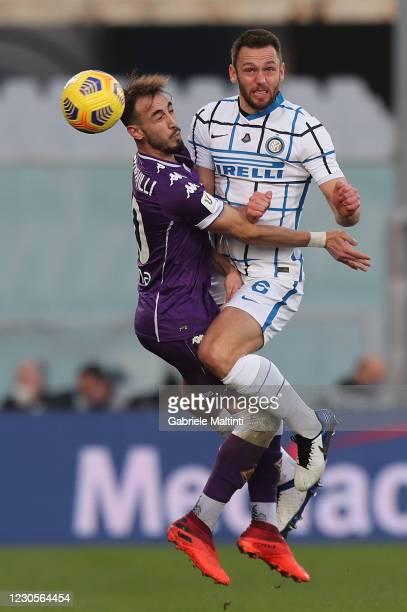Gaetano Castrovilli of ACF Fiorentina battles for the ball with Stefan De Vrij of FC Internazionale during the Coppa Italia match between ACF...