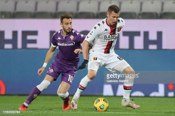 Gaetano Castrovilli of ACF Fiorentina battles for the ball with Lukas Lerager of Genoa CFC during the Serie A match between ACF Fiorentina and Genoa...