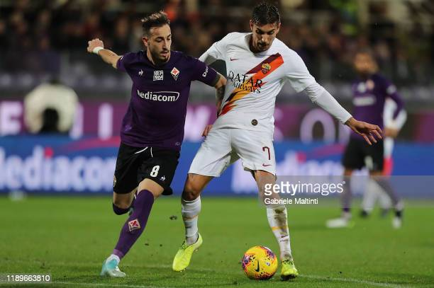Gaetano Castrovilli of ACF Fiorentina battles for the ball with Lorenzo Pellegrini of AS Roma during the Serie A match between ACF Fiorentina and AS...