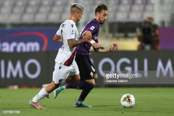 Gaetano Castrovilli of ACF Fiorentina battles for the ball with Nicolas Domiguez of Bologna FC during the Serie A match between ACF Fiorentina and...