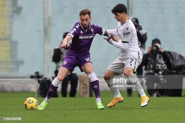 Gaetano Castrovilli of ACF Fiorentina battles for the ball with Riccardo Orsolini of Bologna FC during the Serie A match between ACF Fiorentina and...