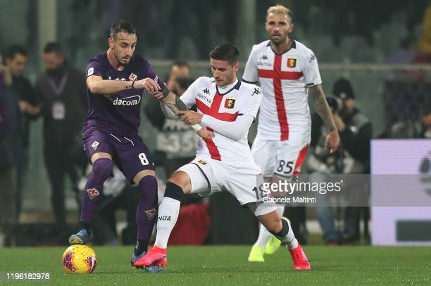 Gaetano Castrovilli of ACF Fiorentina battles for the ball with Paolo Ghiglione of Genoa CFC during the Serie A match between ACF Fiorentina and...