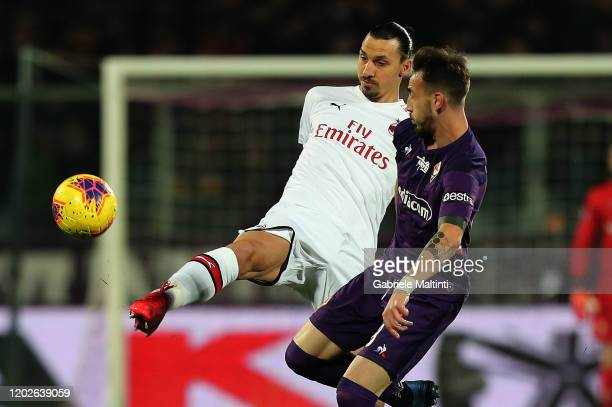 Gaetano Castrrovilli of ACF Fiorentina battles for the ball with Zlatan Ibrahimovic of AC Milan during the Serie A match between ACF Fiorentina and...