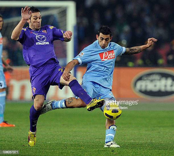 Gaetano D'Agostino of Fiorentina and Ezequiel Lavezzi of Napoli in action during the Serie A match between Napoli and Fiorentina at Stadio San Paolo...