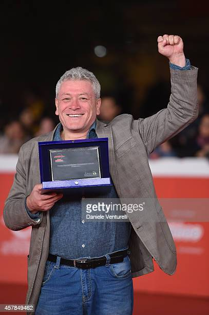Gaetano Di Vaio poses with the DOC/IT Award during the Award Winners Photocall during the 9th Rome Film Festival at Auditorium Parco Della Musica on...