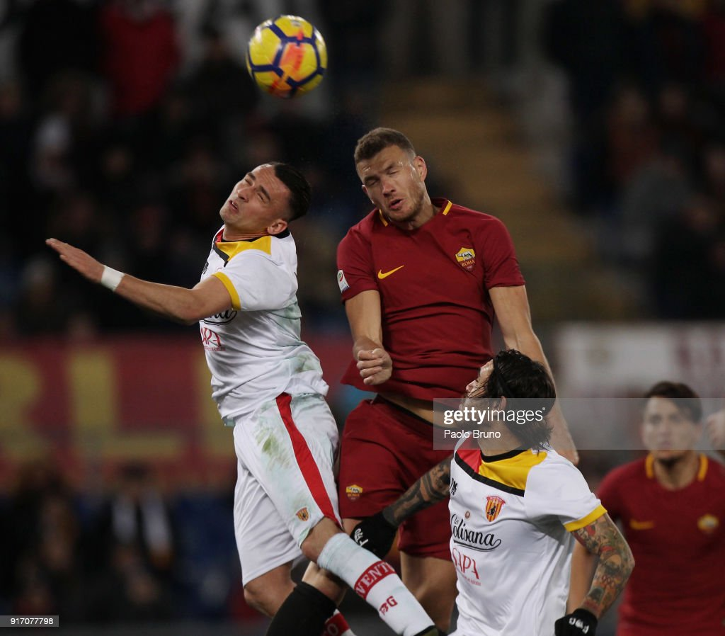 Gaetano Letizia of Benevento Calcio competes for the ball with Edin Dzeko of AS Roma during the serie A match between AS Roma and Benevento Calcio at Stadio Olimpico on February 11, 2018 in Rome, Italy.