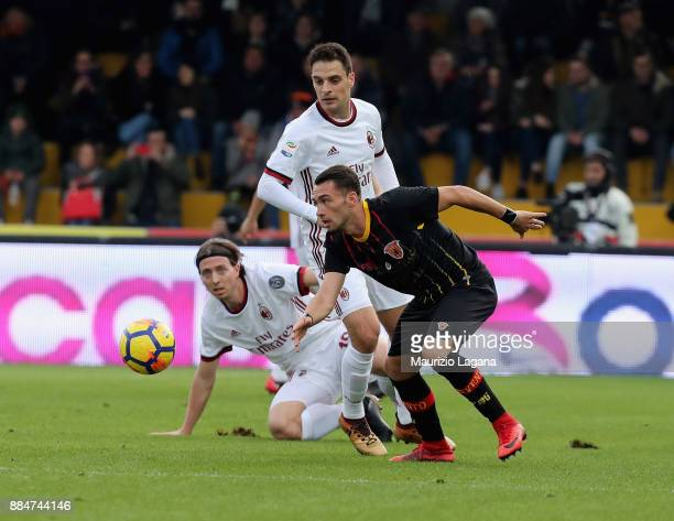 Gaetano Letizia of Benevento competes for the ball with Riccardo Montolivo of Milan during the Serie A match between Benevento Calcio and AC Milan at...