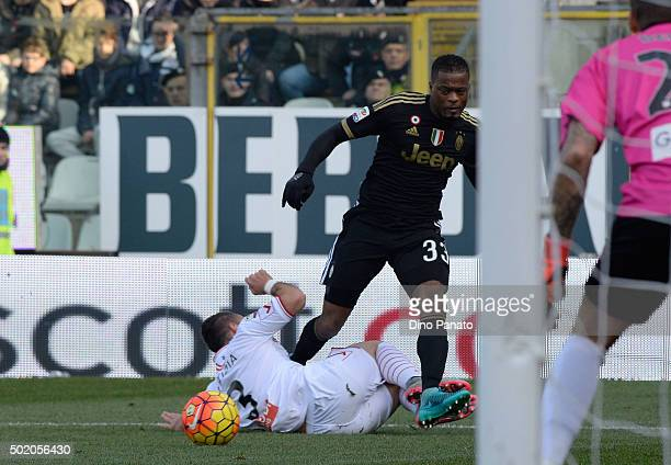 Gaetano Letizia of Carpi FC competes with Patrice Evra of JuventuS FC during the Serie A match between Carpi FC and Juventus FC at Alberto Braglia...