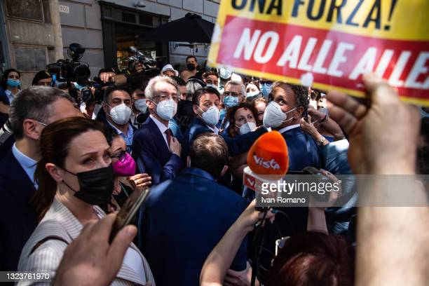 Gaetano Manfredi and Giuseppe Conte at the exit of the press conference welcomed by a crowd of activists of the 5 Star Movement on June 15, 2021 in...